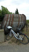 large wine barrel with rental bike in front of it
